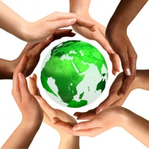 Multiracial Hands Around the Earth Globe